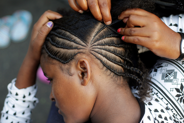 Students at a Malden charter school in Massachusetts were suspended for wearing their hair in braids.
