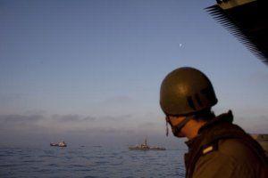 israel-soldier-watches-flotilla