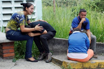 Relatives mourn teenager shot in San Cristobal, Venezuela