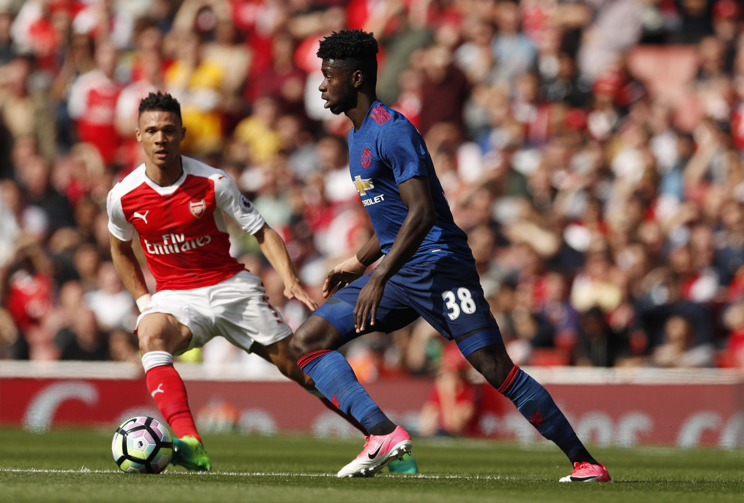 Manchester United defender Axel Tuanzebe, right.