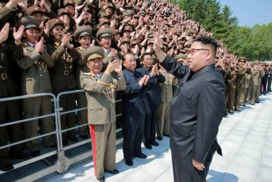 Kim Jong Un Waves at Crowd