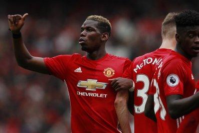 Manchester United midfielder Paul Pogba, left.