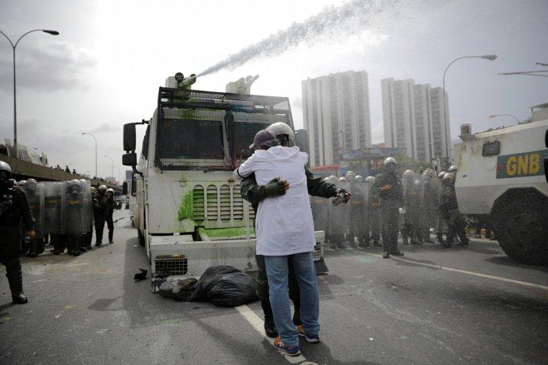 Venezuela doctor embraces soldier