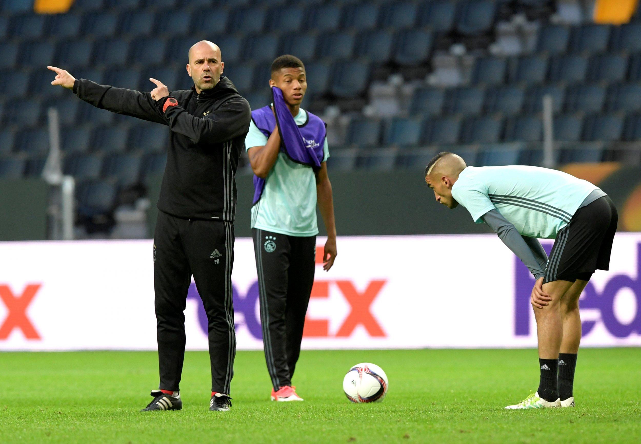 Ajax coach Peter Bosz, left.