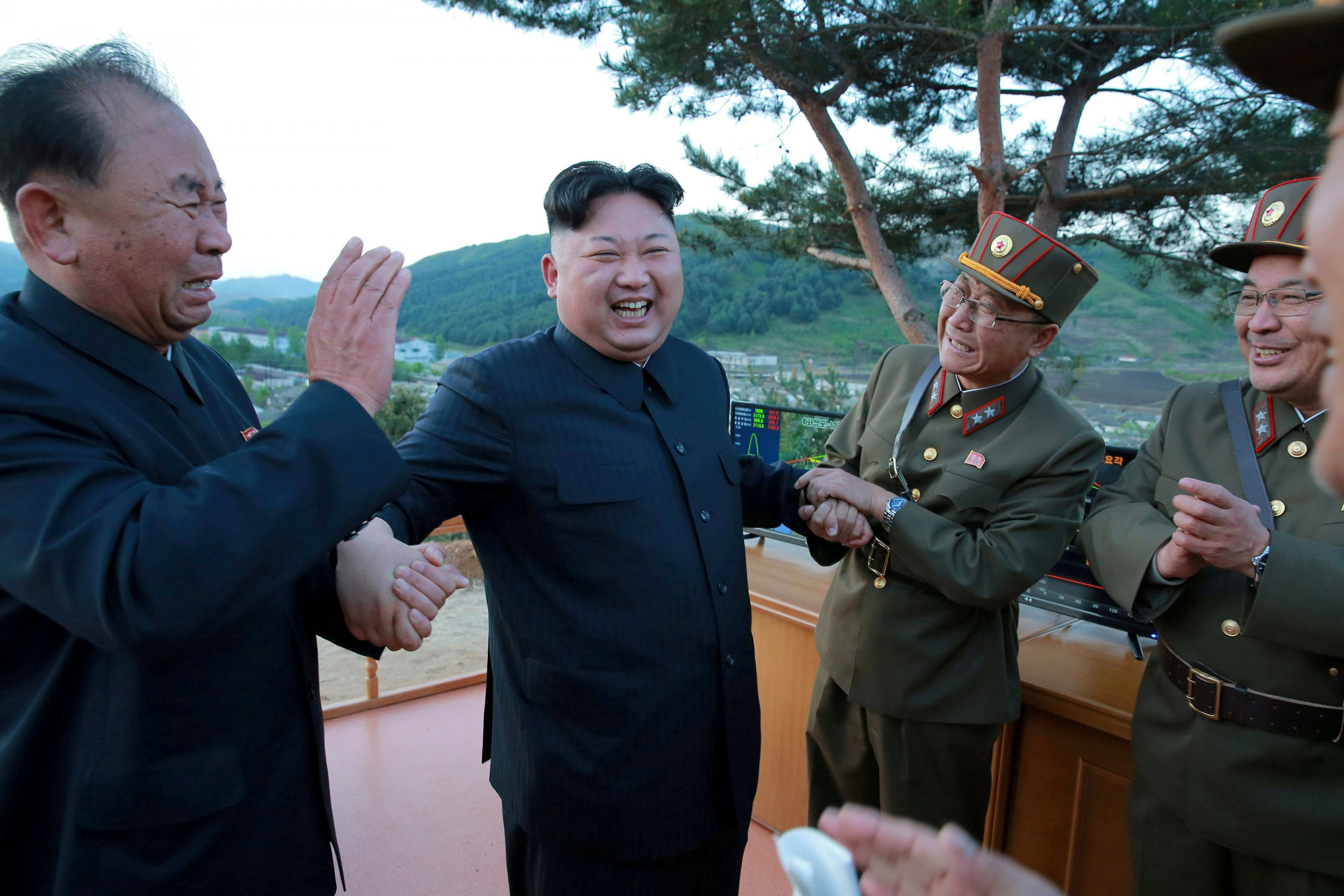 North Korea S Power Trio Who Are The Men Smiling With Kim Jong Un After Missile Launches