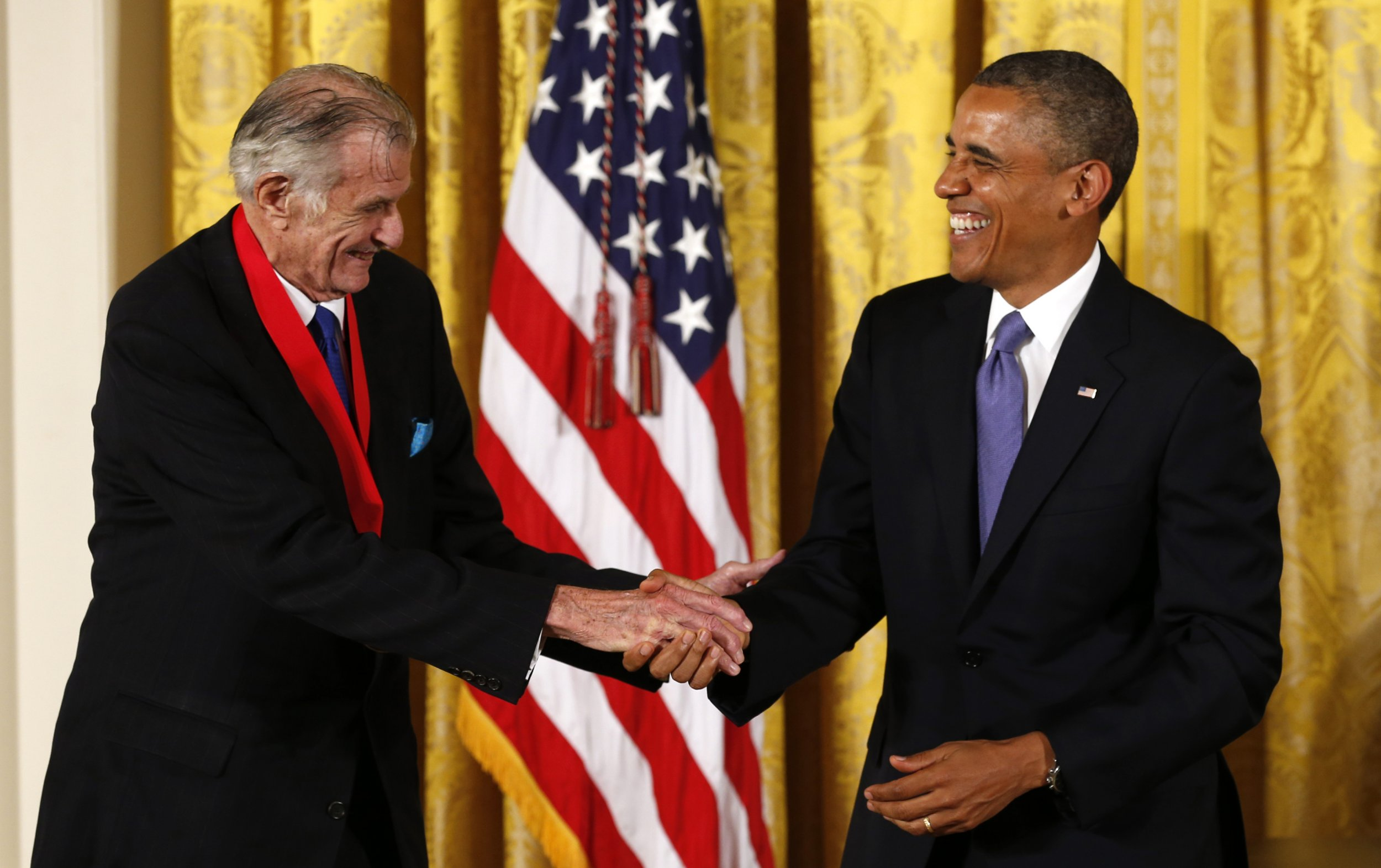 Frank Deford, left, with 44th President of the United States Barack Obama.