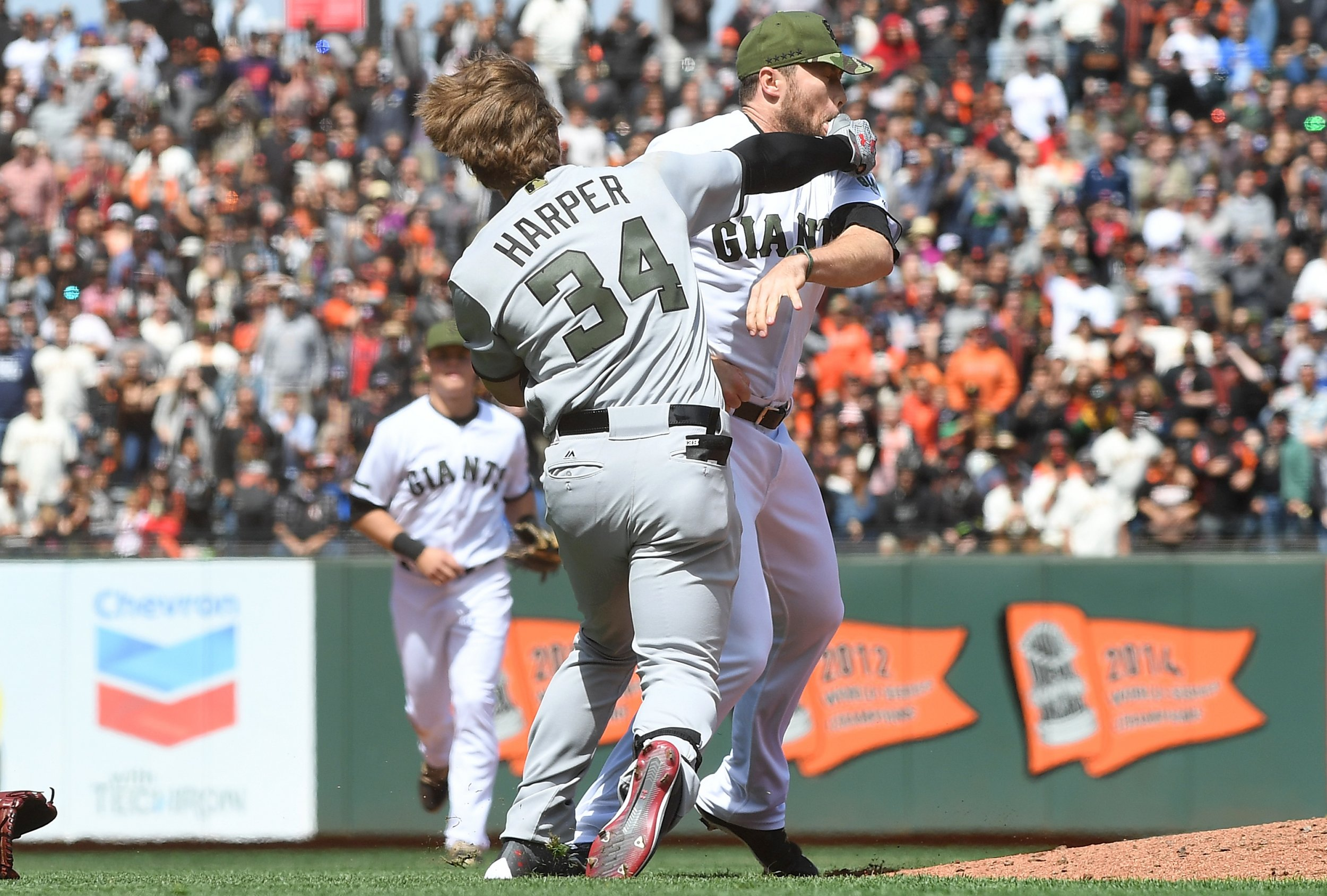 Bryce Harper of the Washington Nationals, left, and San Francisco Giants pitcher Hunter Strickland throw punches at AT&T Park, San Francisco, May 29.