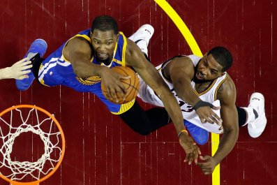 Golden State Warriors' Kevin Durant, left, competes with Tristan Thompson.