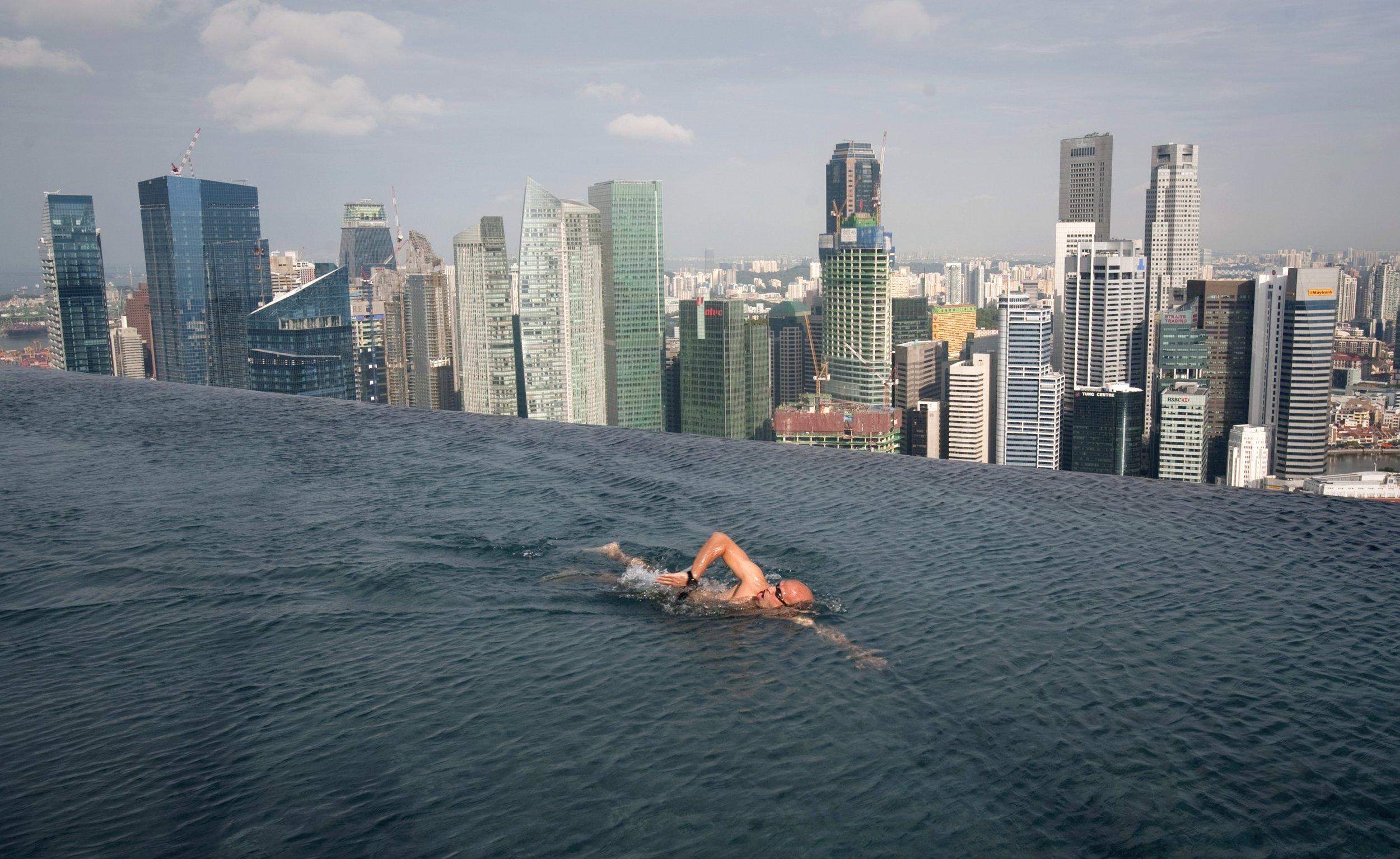 man swimming in singapore