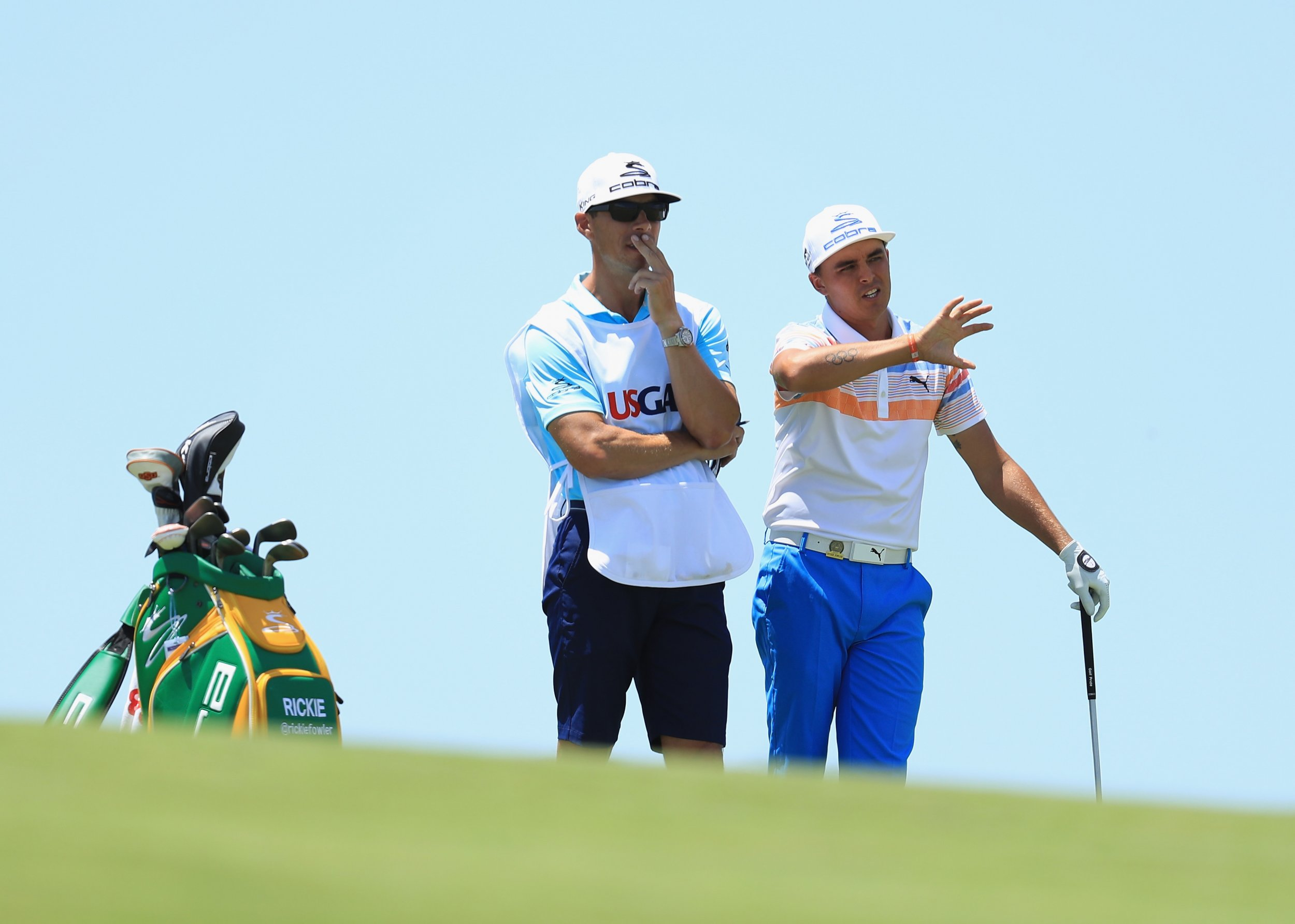Rickie Fowler of the United States, right, and caddie Joe Skovron in Hartford, Wisconsin, June 15.