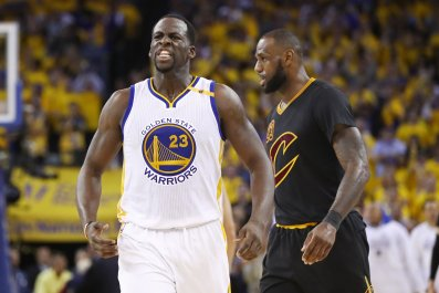 Draymond Green of the Golden State Warriors, left, with the Cleveland Cavaliers' LeBron James in Oakland, California, June 12.
