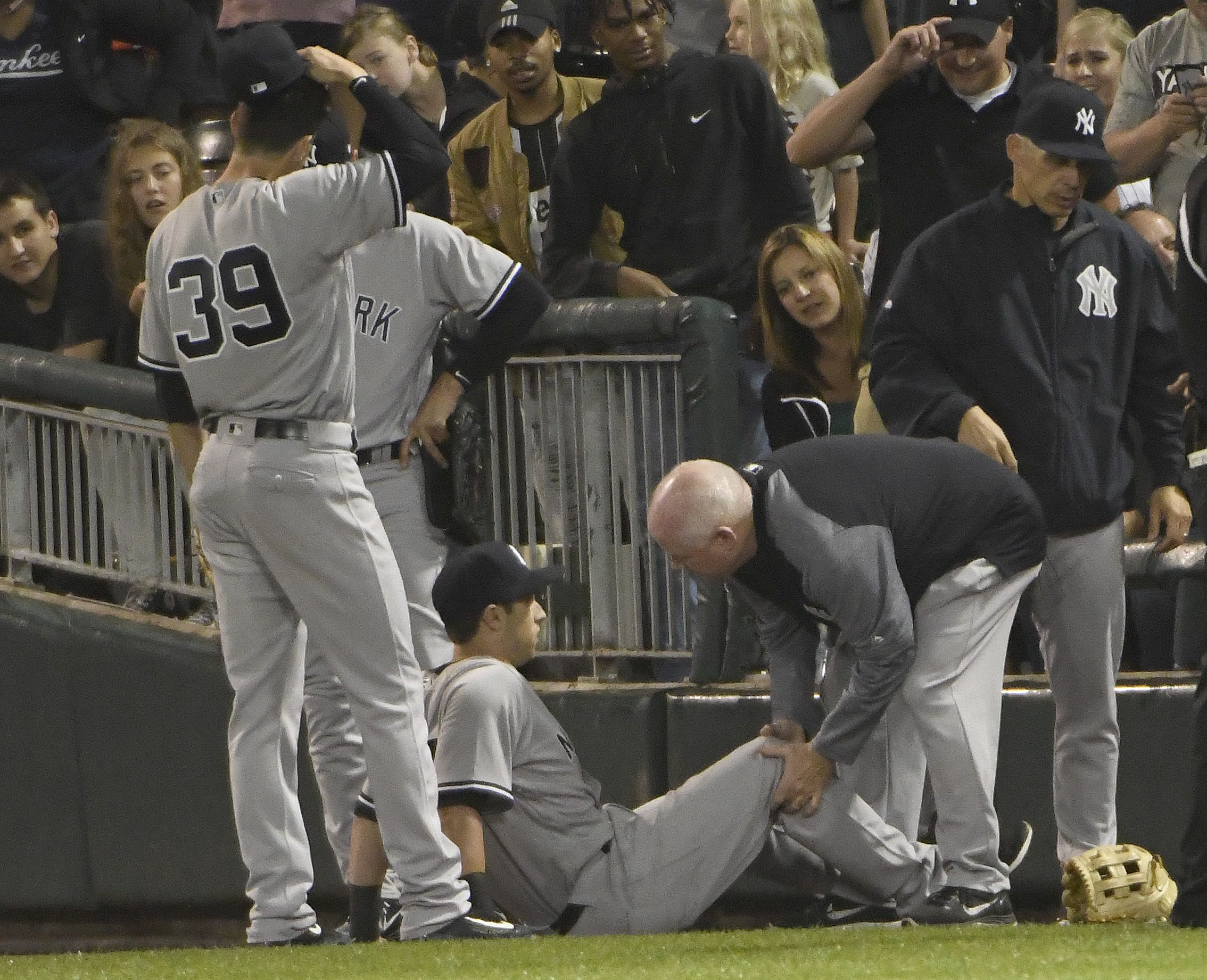 Dustin Fowler (on the ground) of the New York Yankees at Guaranteed Rate Field, Chicago, June 29.