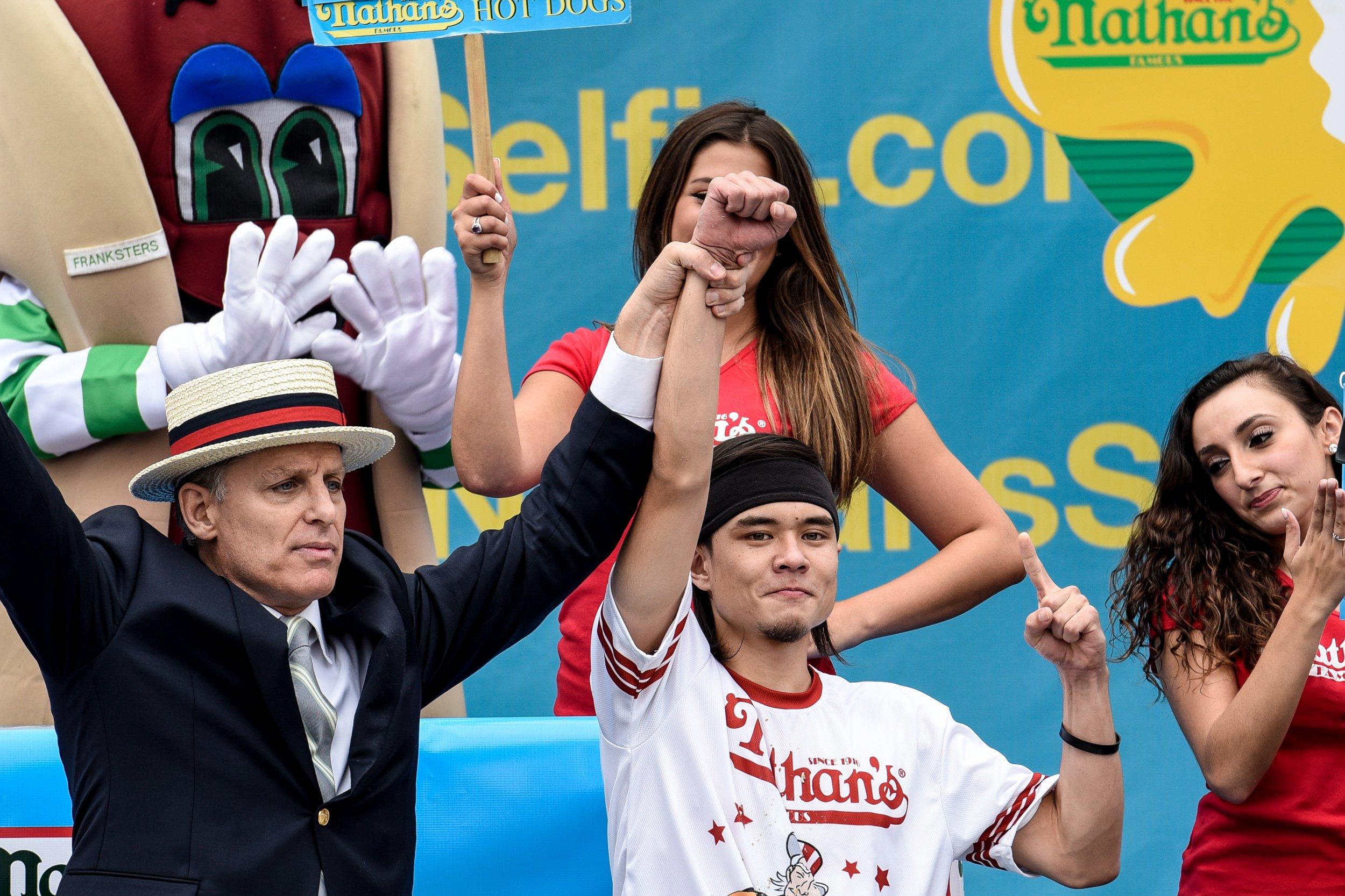 Matt Stonie, center, in Coney Island, New York, July 4 2015.