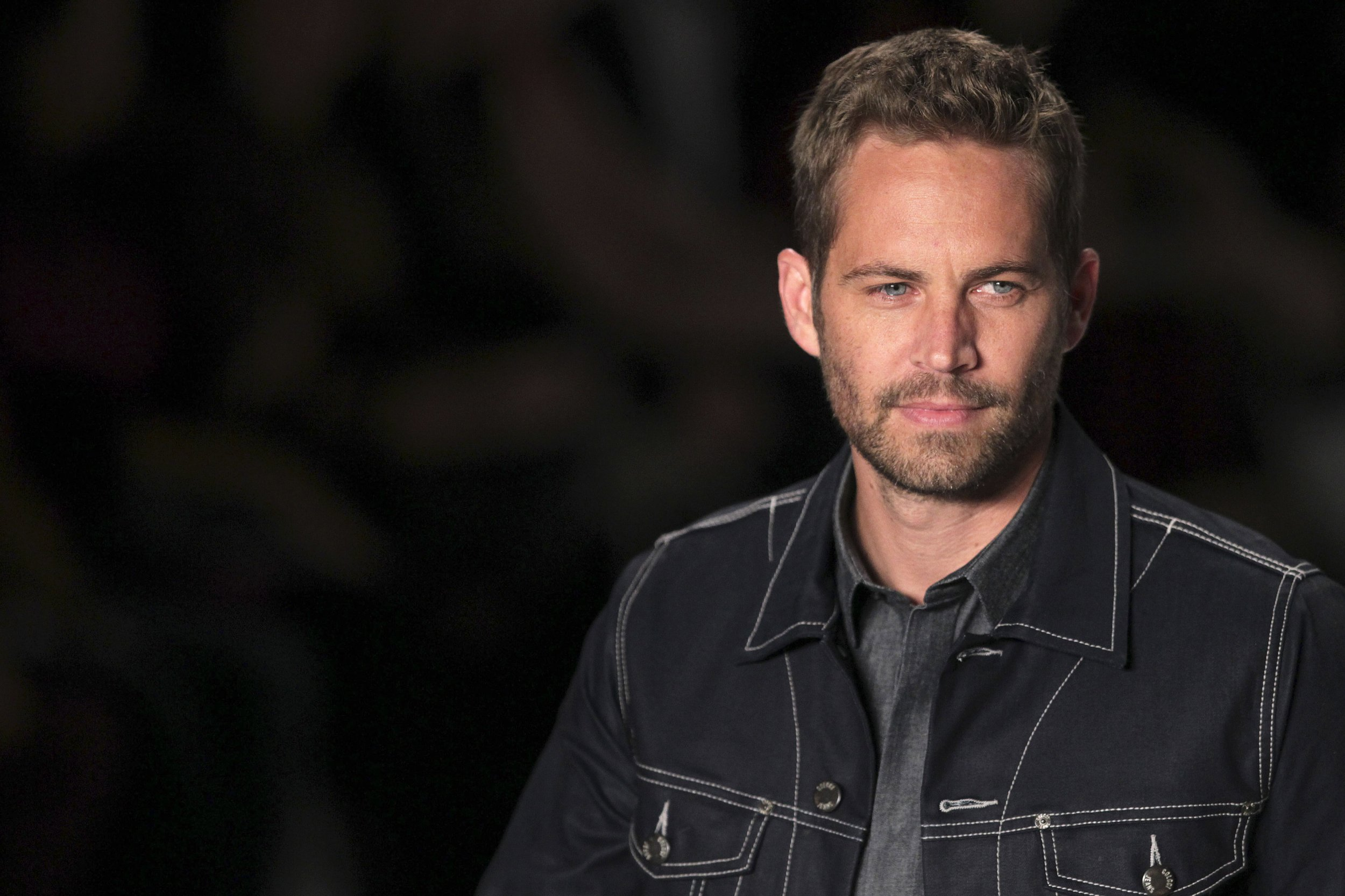 US Actor Paul Walker Presents A Creation From Colccis 2013 2014 Summer Collection During Sao Paulo Fashion Week March 21 Leading Star In