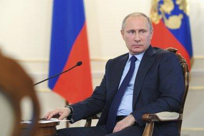 Putin sits