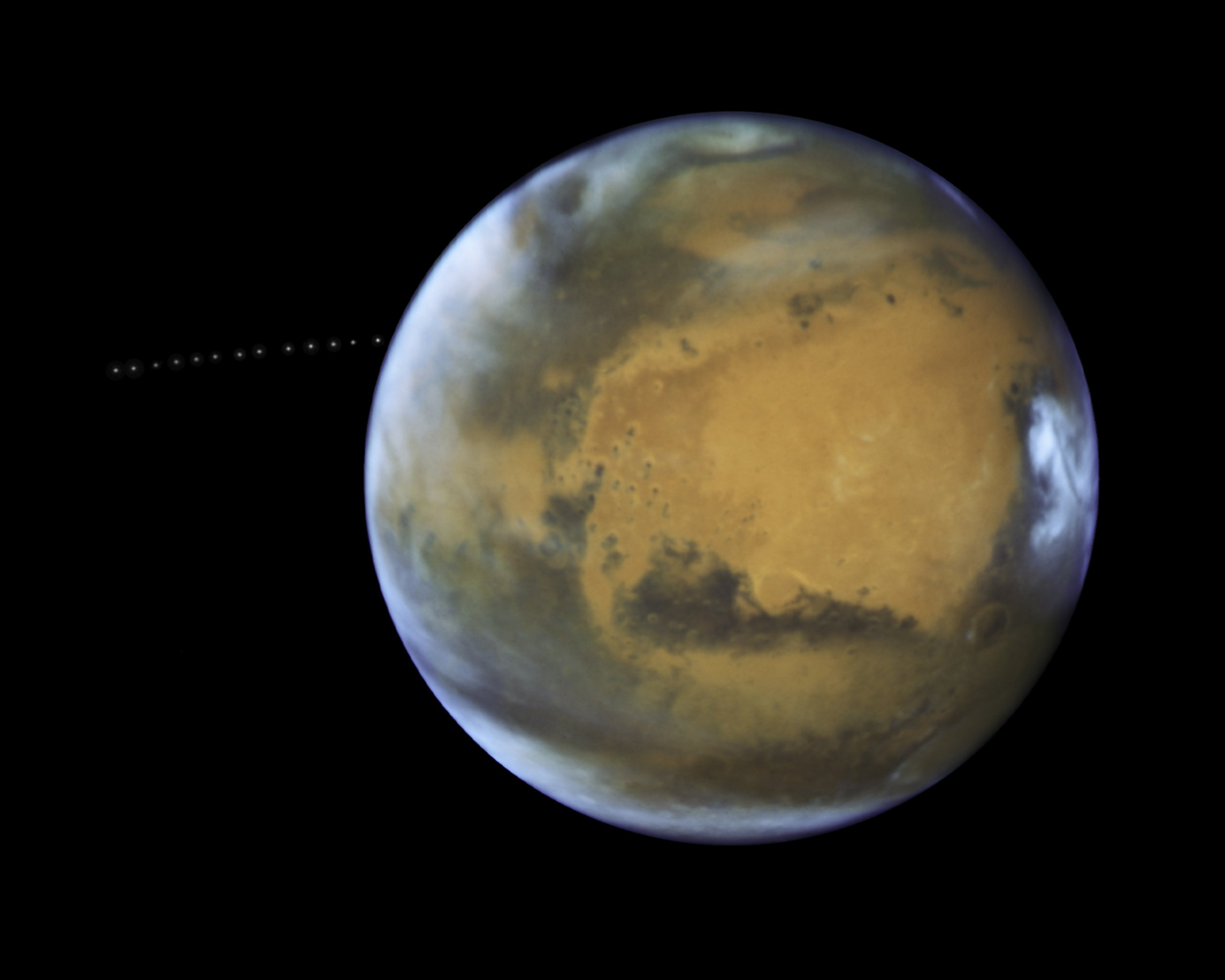 Mars moon Phobos orbits the red planet in a beautiful time-lapse captured by Hubble