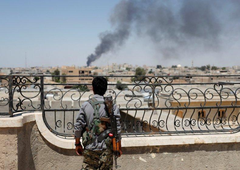Kurdish fighter near Raqqa