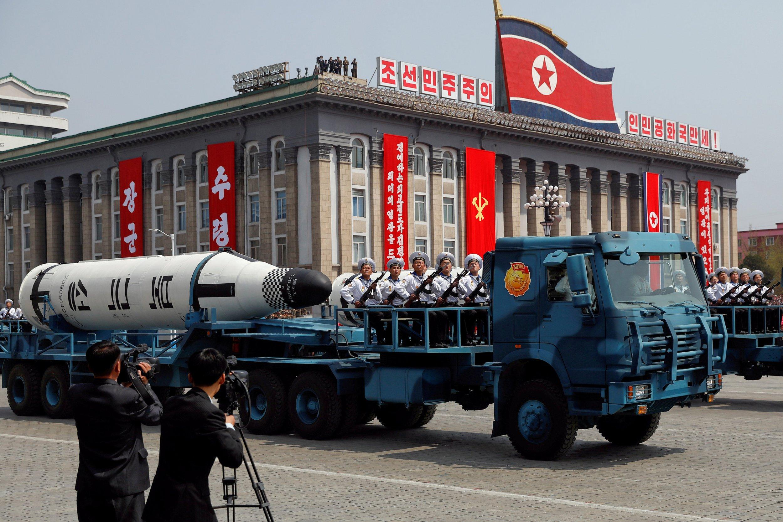 North Korea parades missile