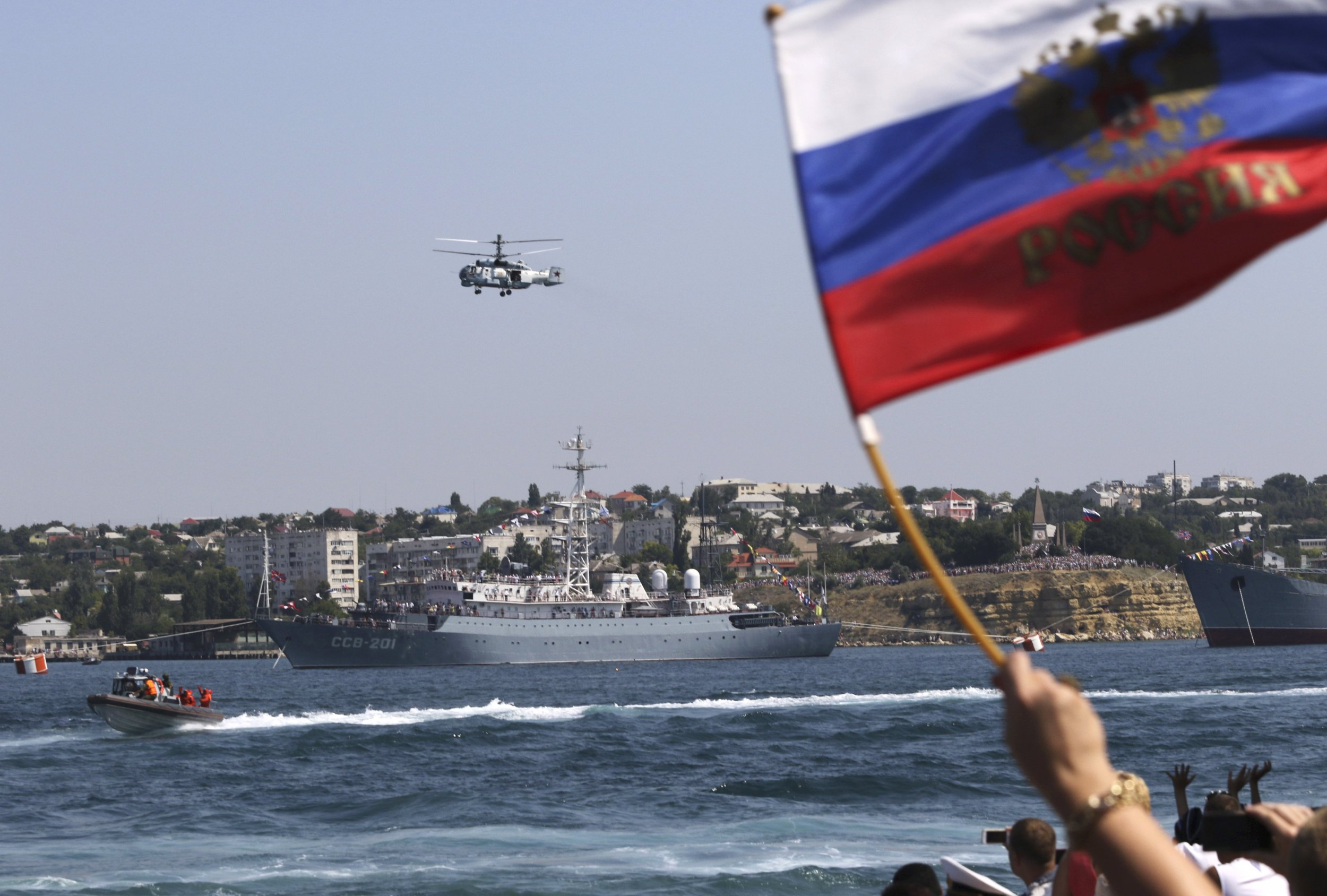Russia's defense minister plots reinforcement in south, near Ukraine and Black Sea