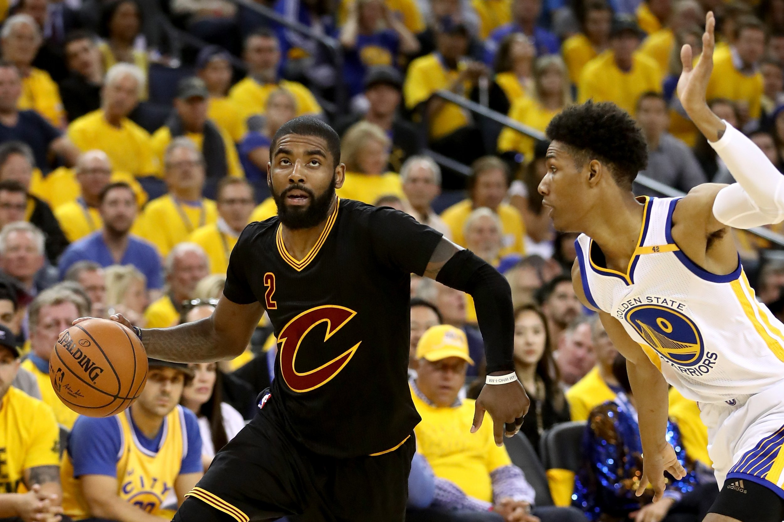 Cleveland Cavaliers point guard Kyrie Irving, left.