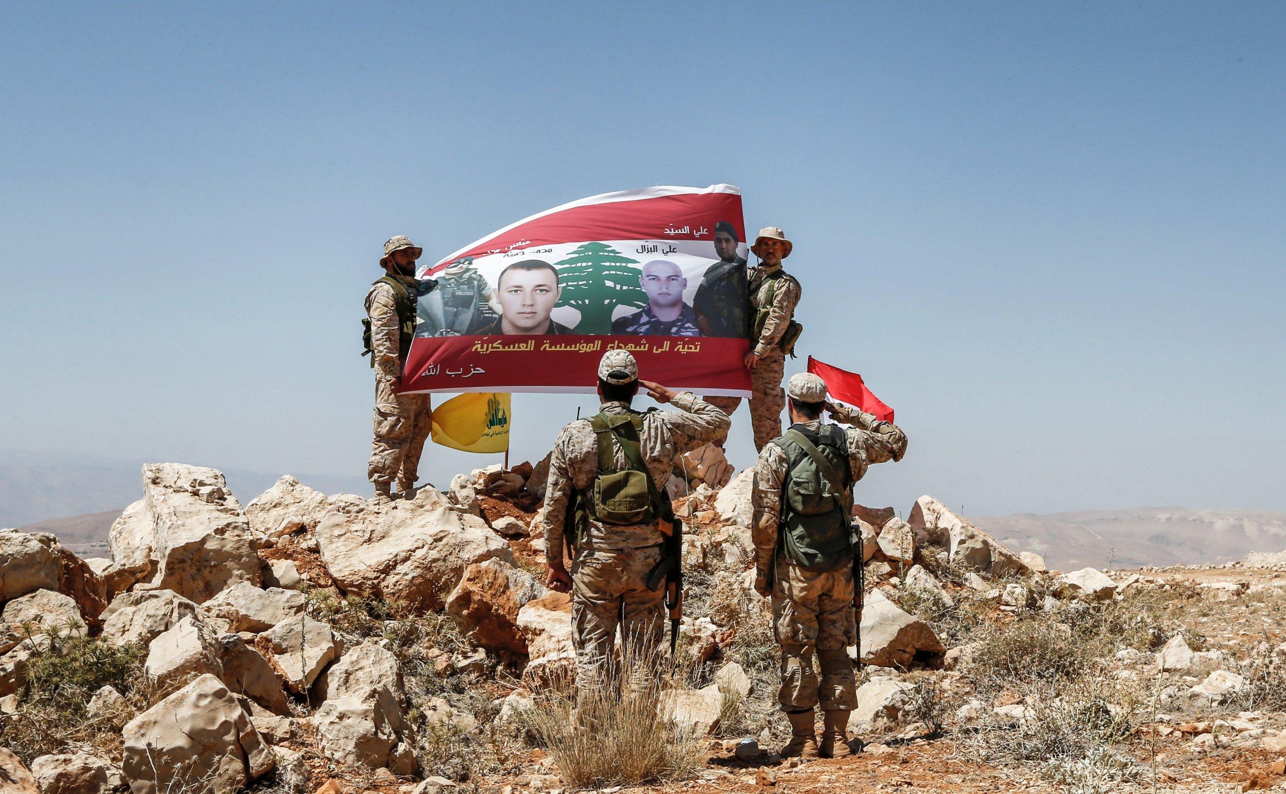 Hezbollah salute a flag