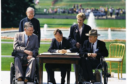 Bush Signs Americans with Disabilities Act