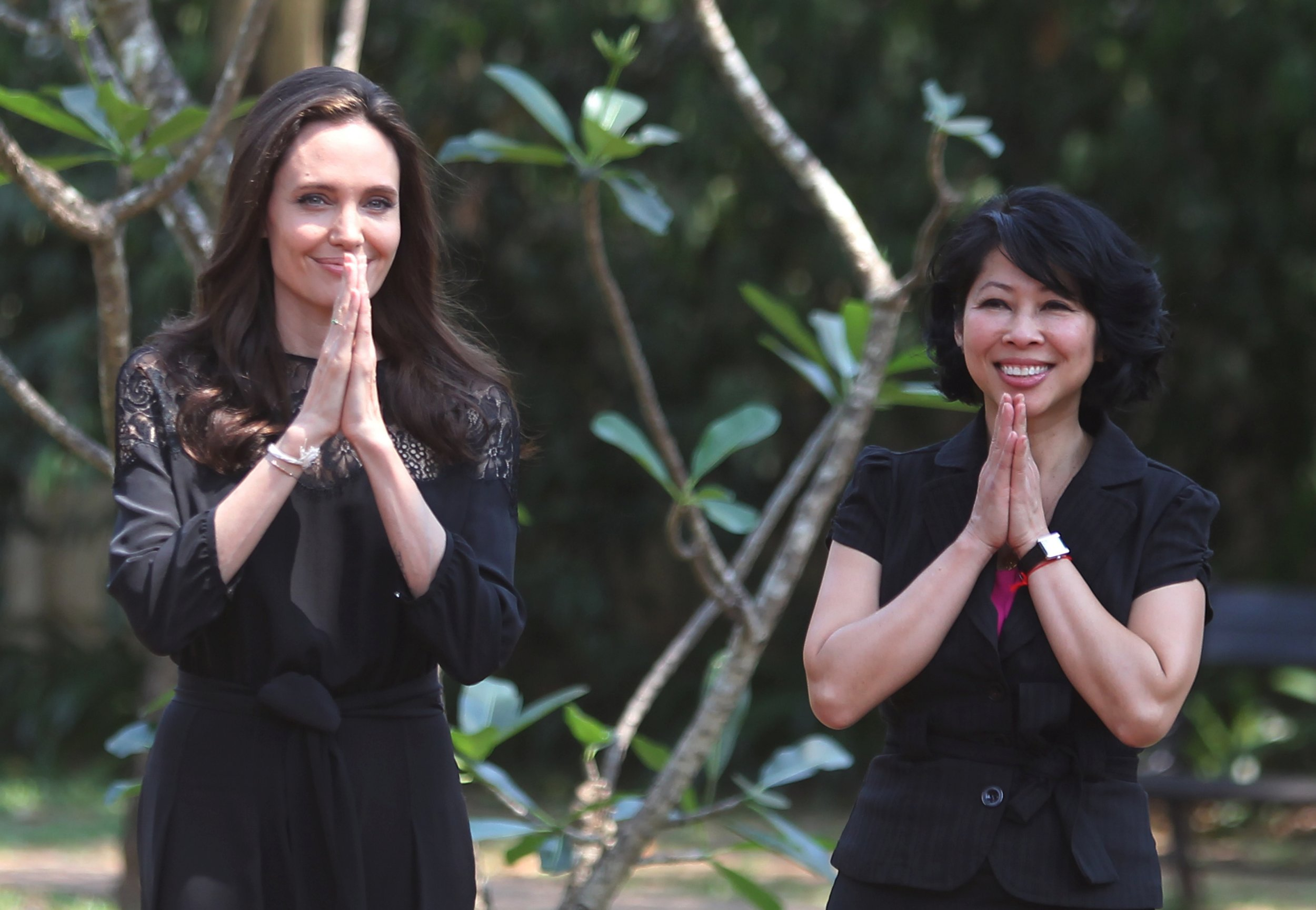 Image result for angelina jolie with cambodian people smile