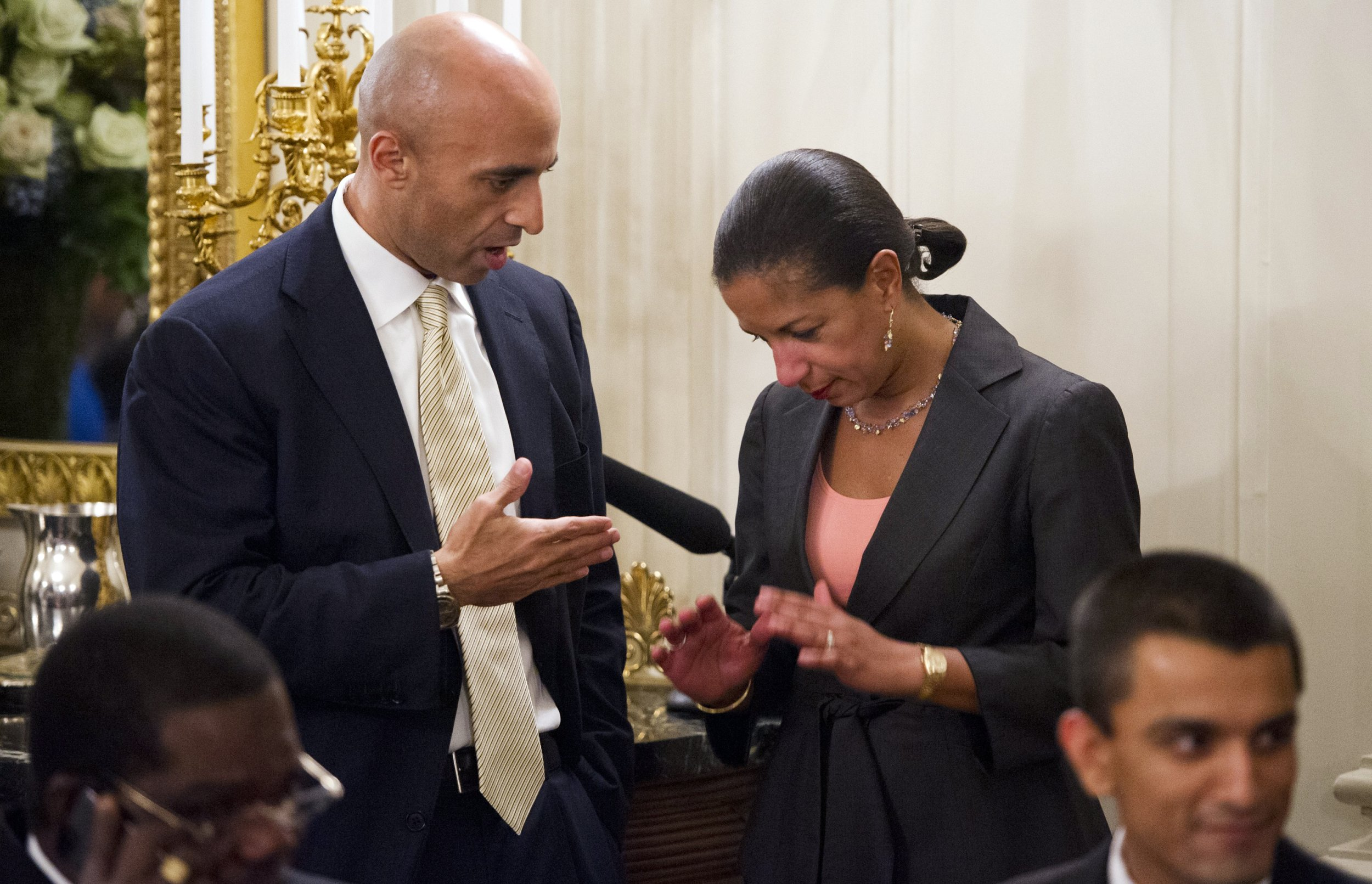 National Security Adviser Susan Rice (R) speaks with Yousef Al Otaiba
