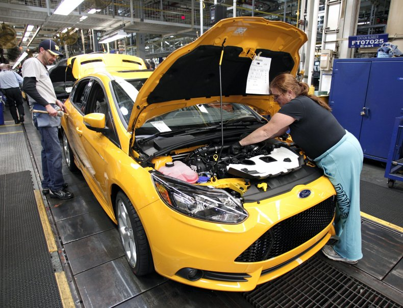 Ford workers on assembly line