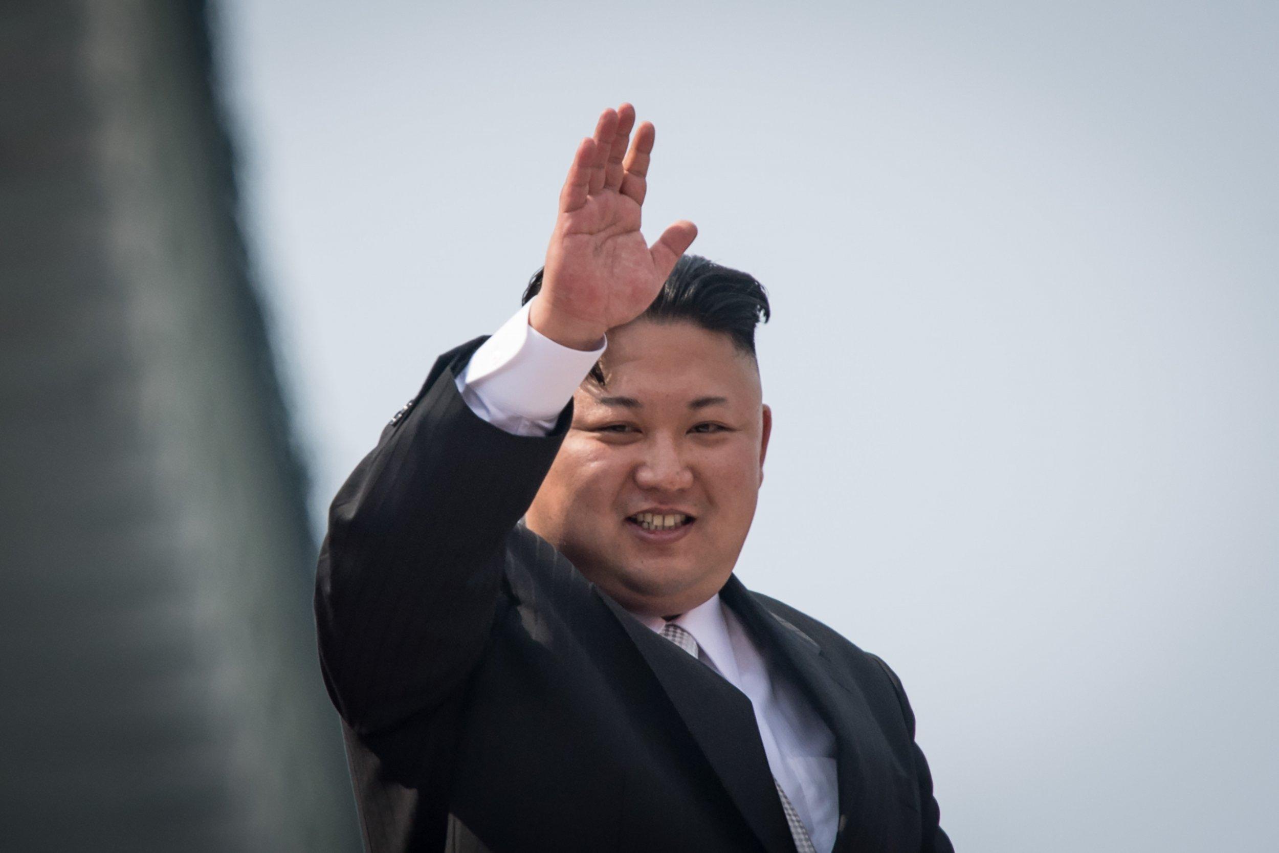 Kim Jong Un waves