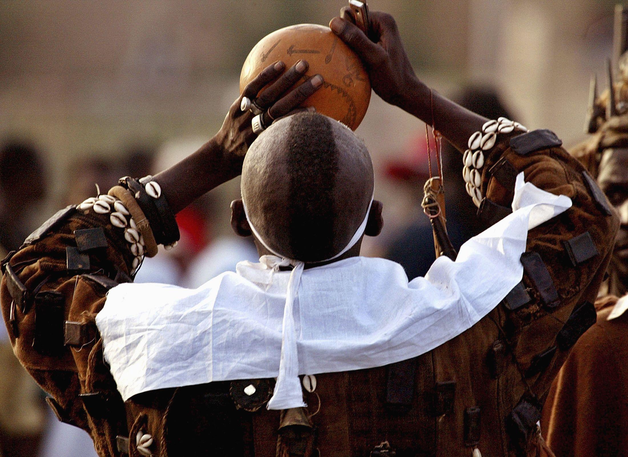 Traditional healer drinks animal blood