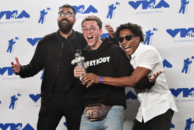 Logic and Damian Lemar Hudson pose with the Best Fight Against The System award
