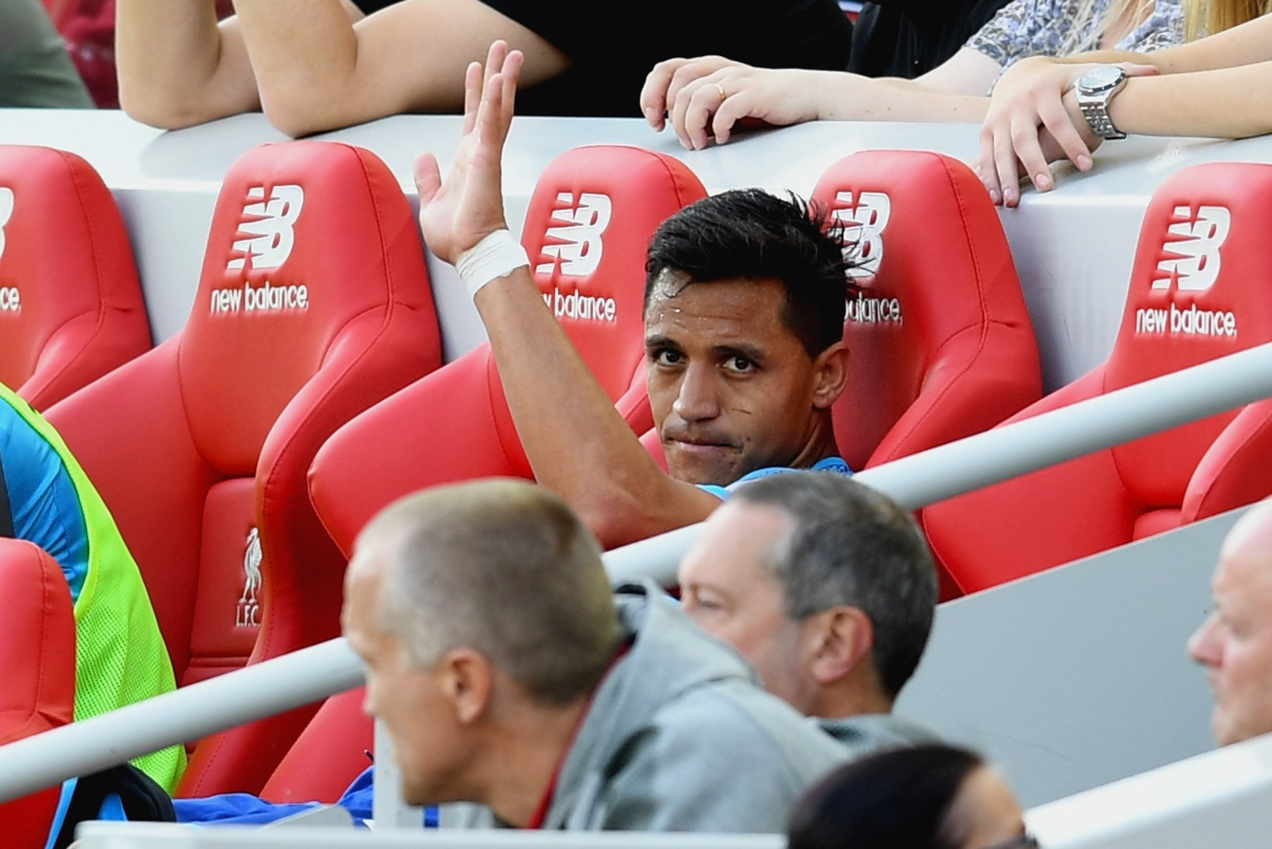 Arsenal striker Alexis Sanchez, center.