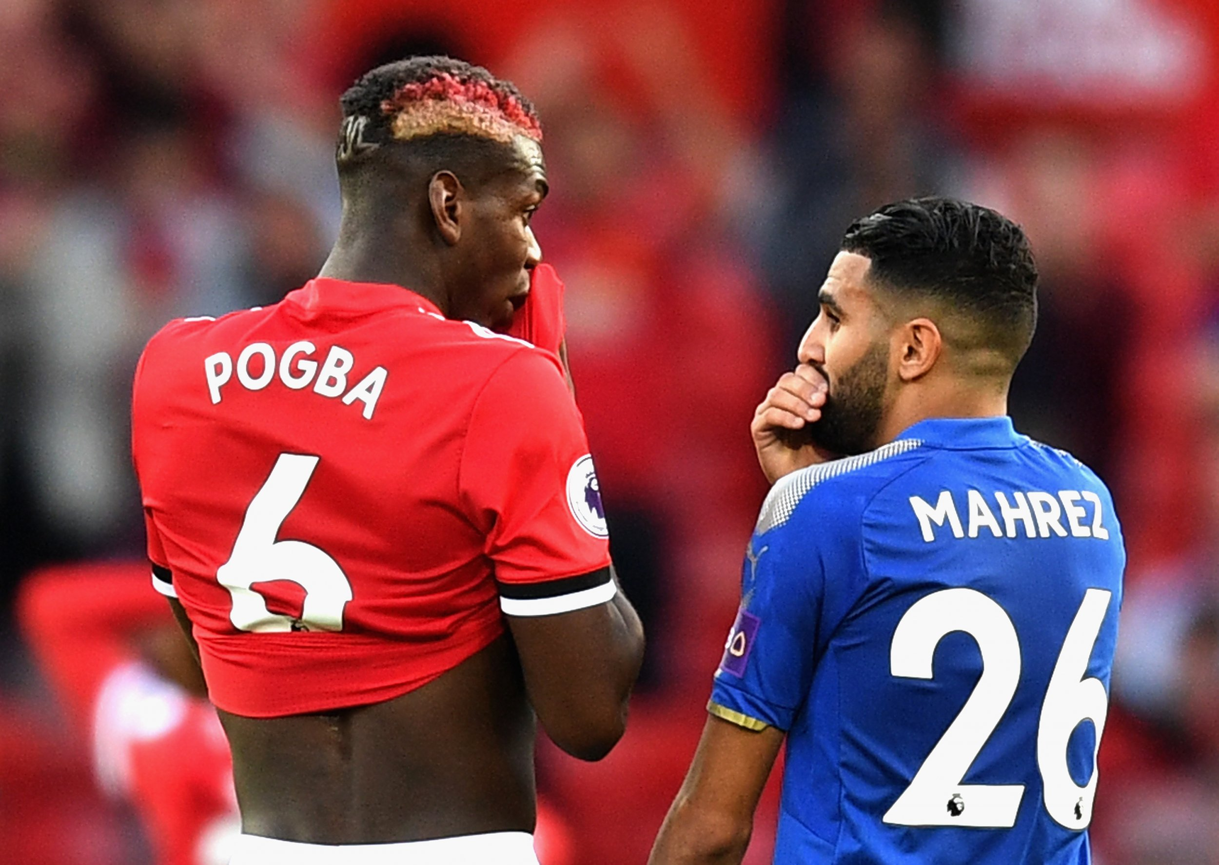 Riyad Mahrez, right, with Manchester United midfielder Paul Pogba.