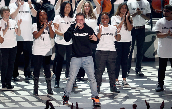Logic opens up on the inspiration behind his powerful suicide prevention song