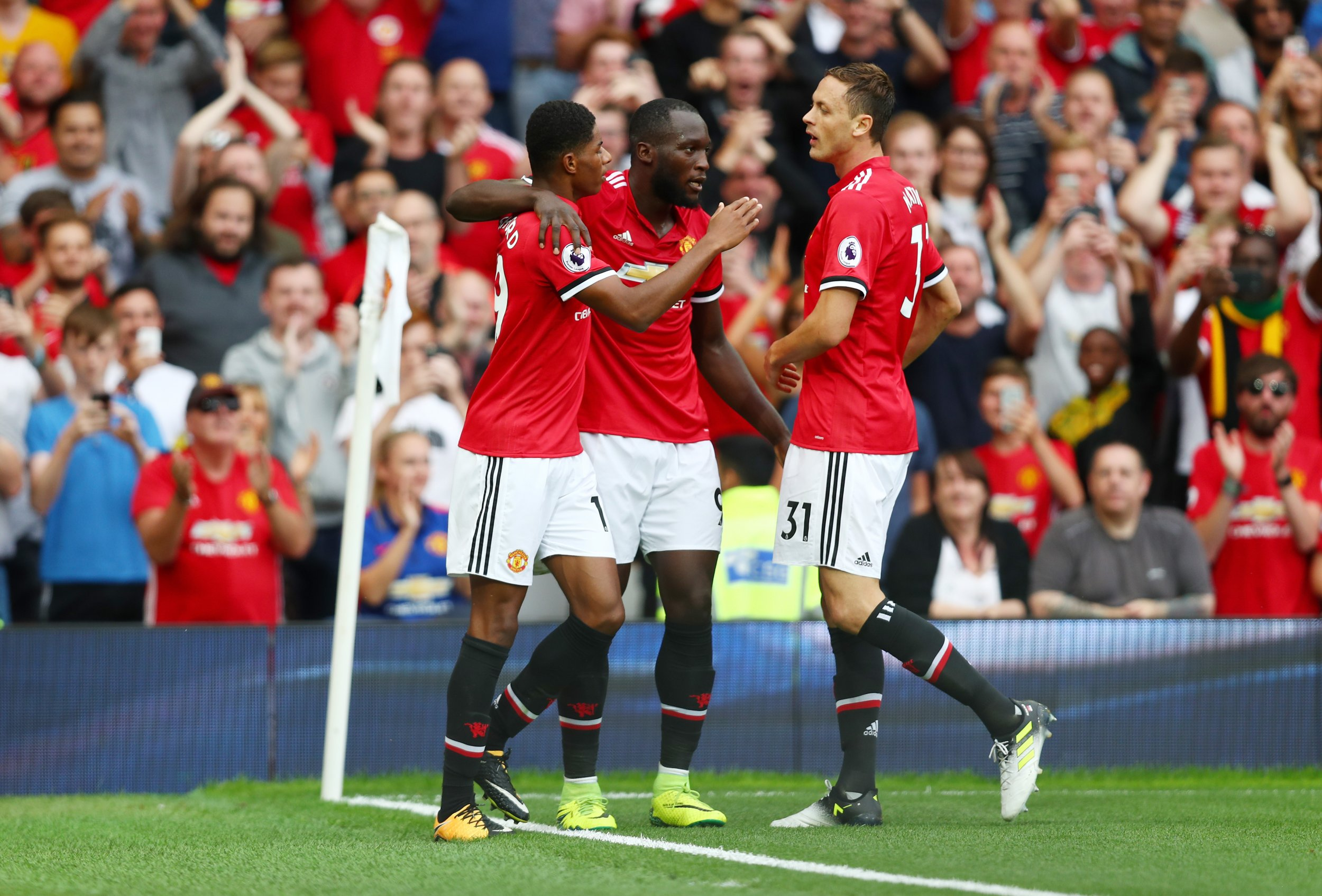 Romelu Lukaku, center, and Nemanja Matic, right, of Manchester United.