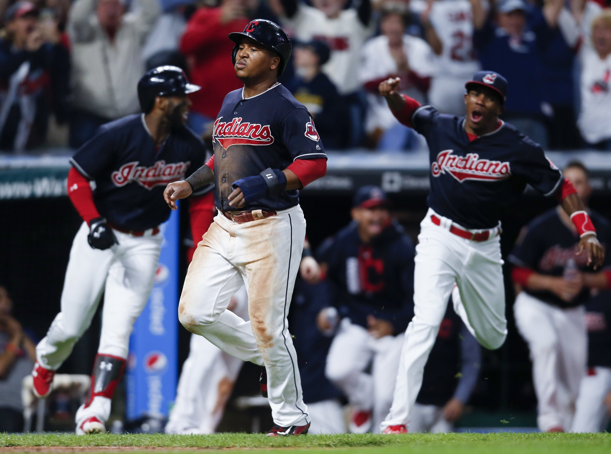 Jose Ramirez #11 of the Cleveland Indians scores the game winning run on a single by Jay Bruce #32 against the Kansas City Royals at Progressive Field, Cleveland, September 14.