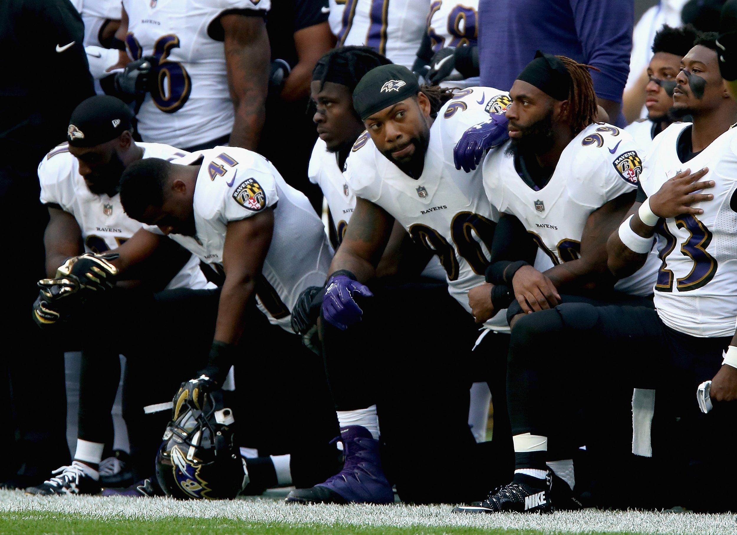 ravens kneeling