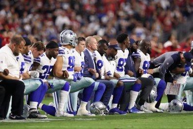 Dallas Cowboys link arms