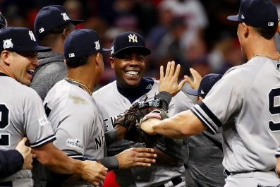 Yankees closer Aroldis Chapman, center, celebrates the ALDS victory over the Cleveland Indians.