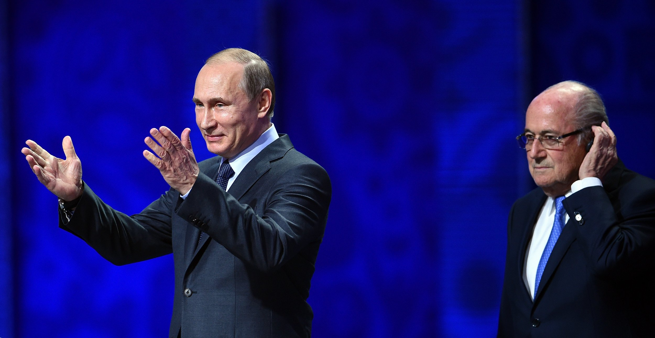 Vladimir Putin, President of Russia, with former FIFA president Sepp Blatter, right, at The Konstantin Palace, Saint Petersburg, July 25 2015.