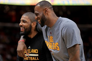 Kyrie Irving, left, with LeBron James.
