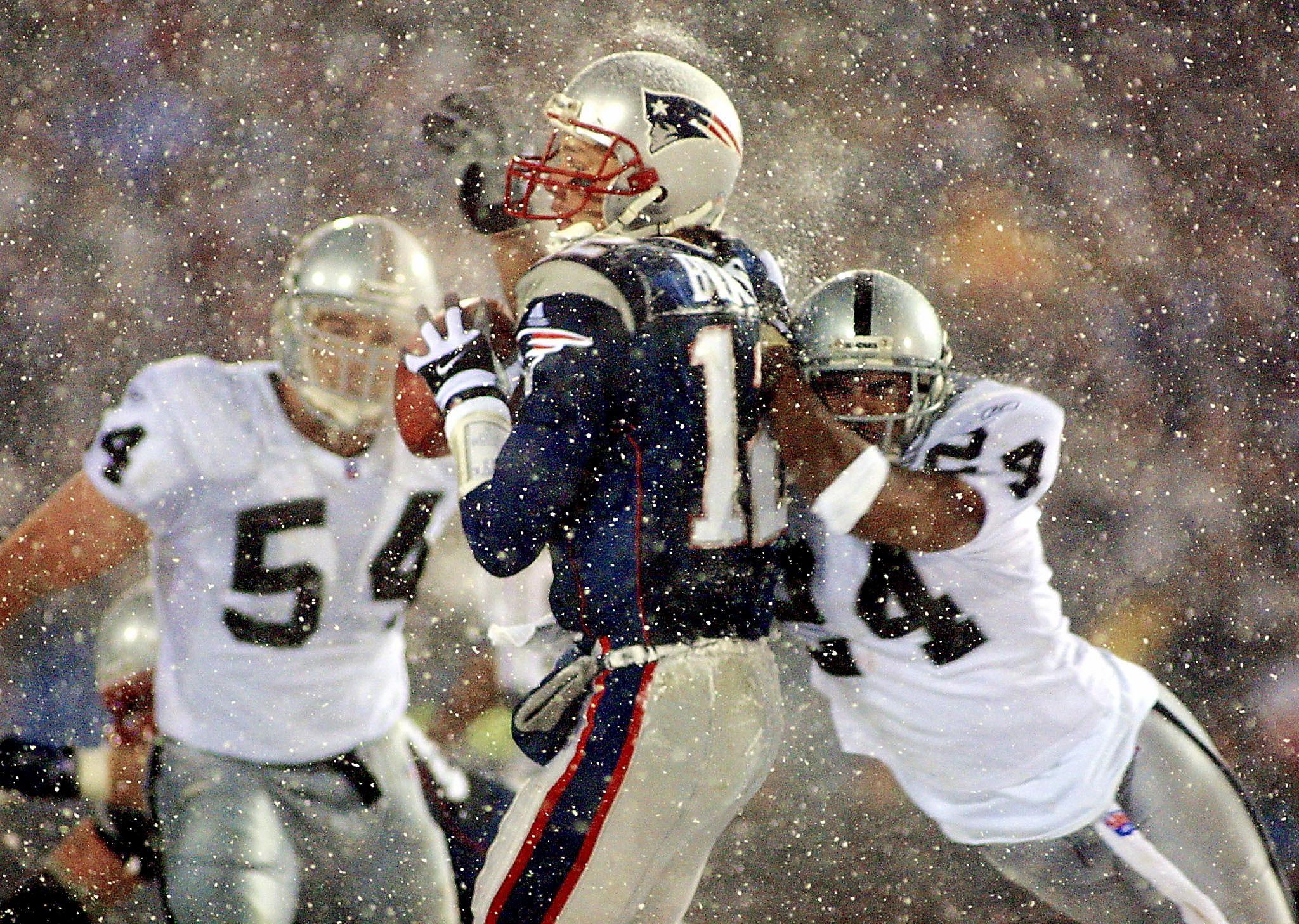New England Patriots quarterback Tom Brady, center.