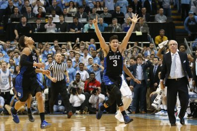 Derryck Thornton, left, watches as teammate Grayson Allen of the Duke Blue Devils celebrates in Chapel Hill, North Carolina, February 17 2016.