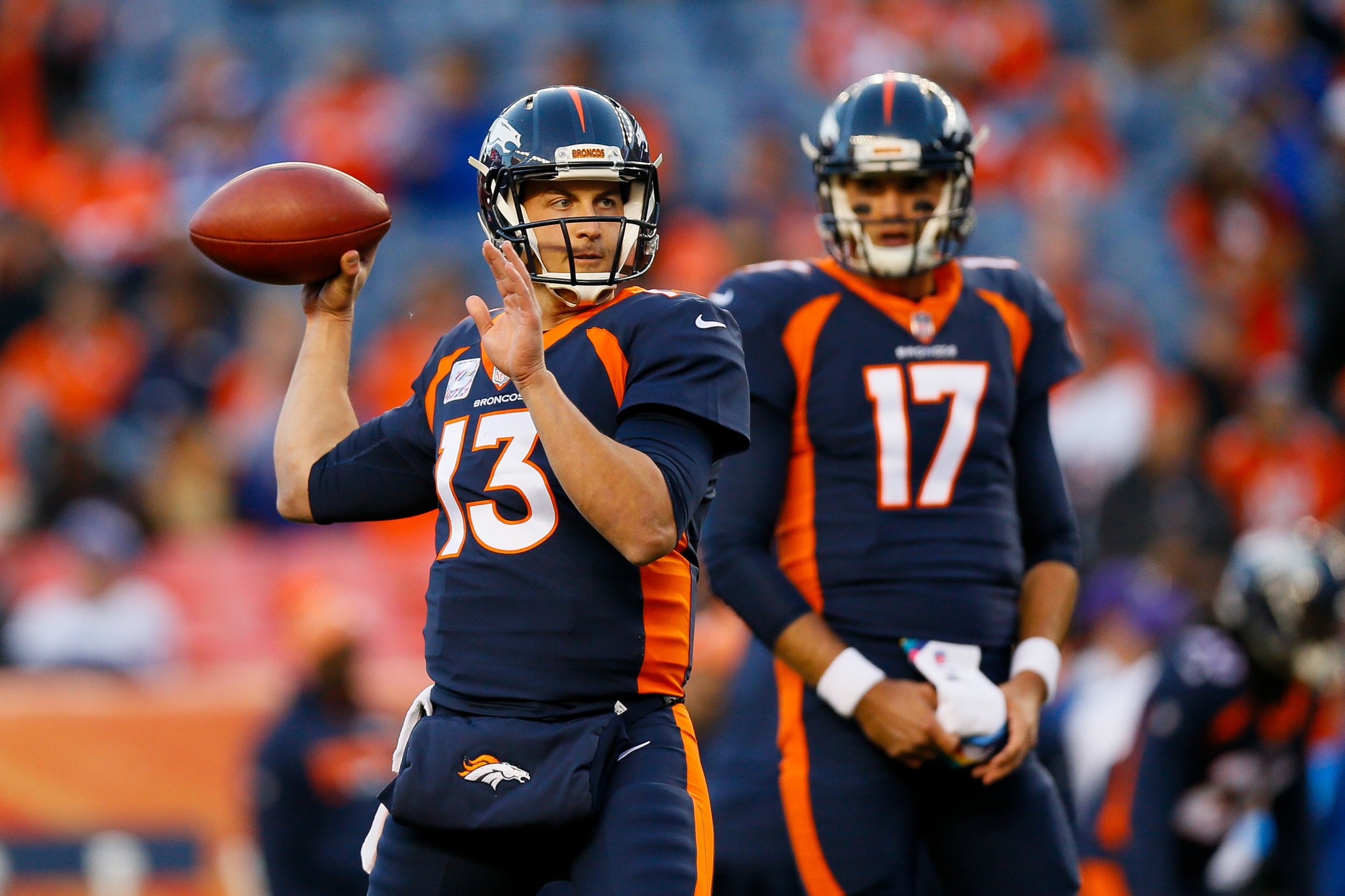 Quarterback Trevor Siemian of the Denver Broncos, left, with teammate Brock Osweiler, right, at Mile High, Denver, October 15.