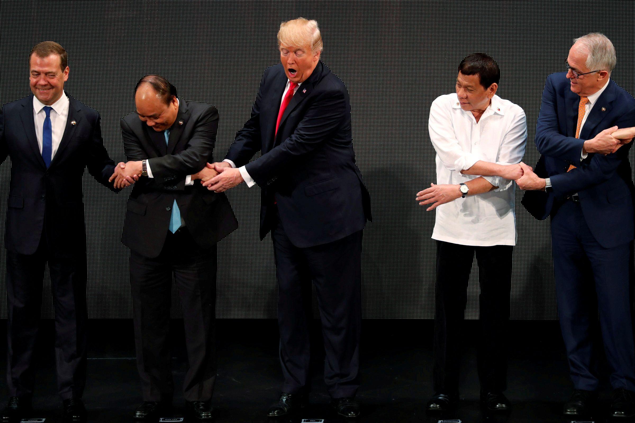 11_13_Trump_ASEAN_Handshake