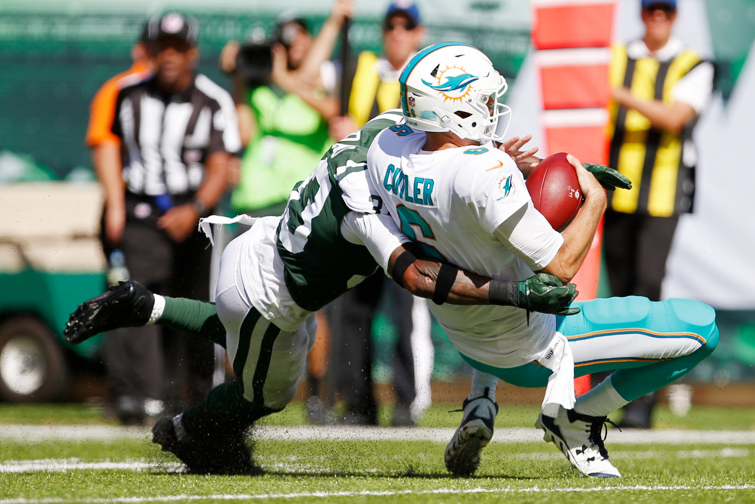 Miami Dolphins quarterback Jay Cutler, right.
