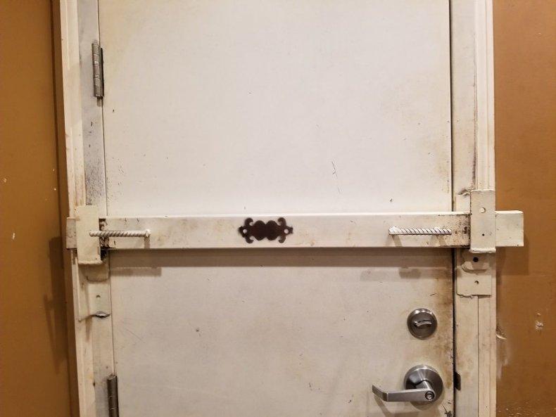 John Mcafee bedroom door security