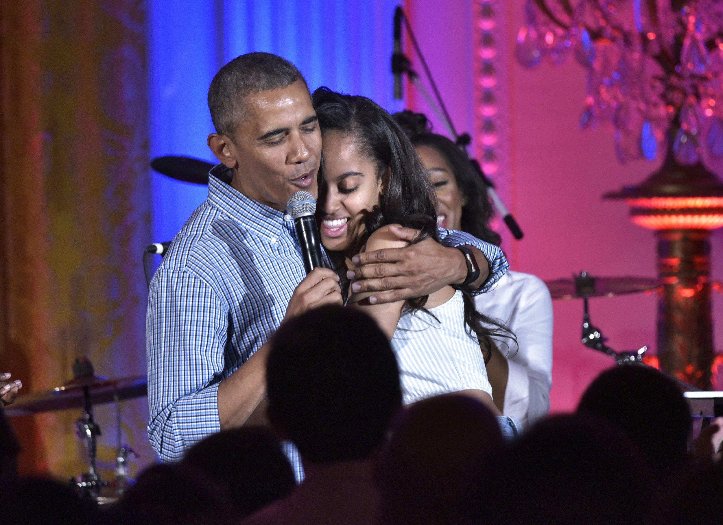 Obama and Malia hug