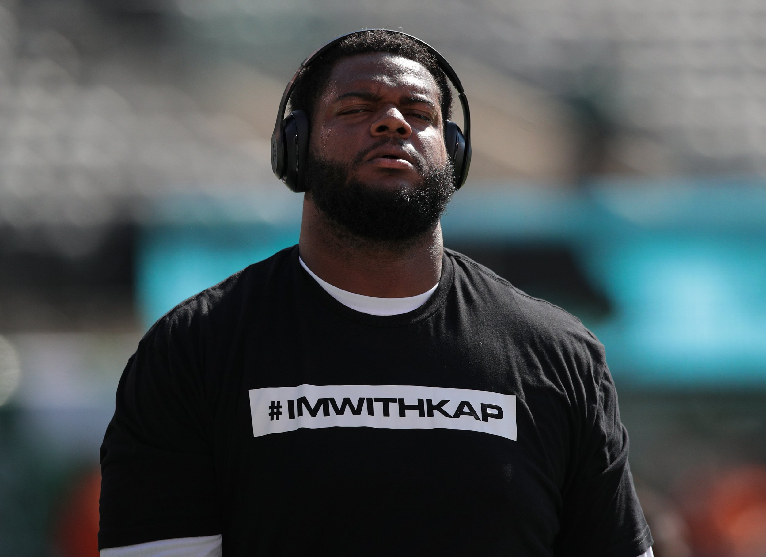 Jordan Phillips of the Miami Dolphins wears a t-shirt in support of former NFL quarterback Colin Kaepernick in East Rutherford, New Jersey, September 24.
